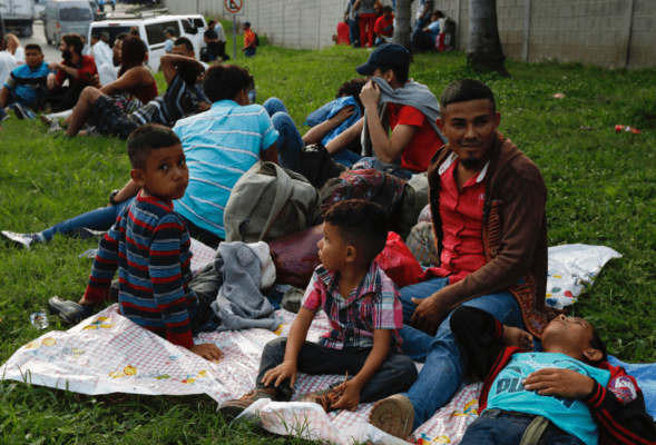 As new U.S.-bound caravan grows to more than 2,000, Mexicans lash out