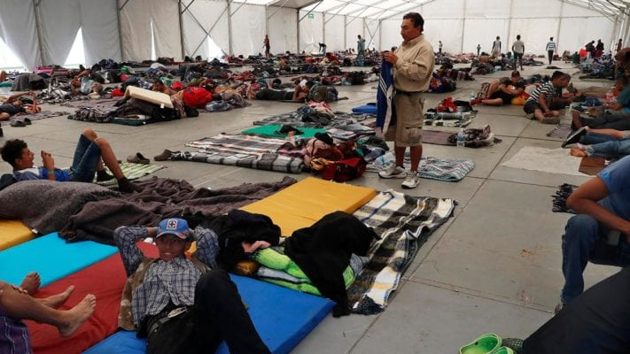 Latest migrant caravan begins to flood Mexico City as 'remain in Mexico' policy begins