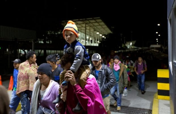 Migrant caravan freely crosses Mexican border after gates were left open, authorities avoided 'confrontation'