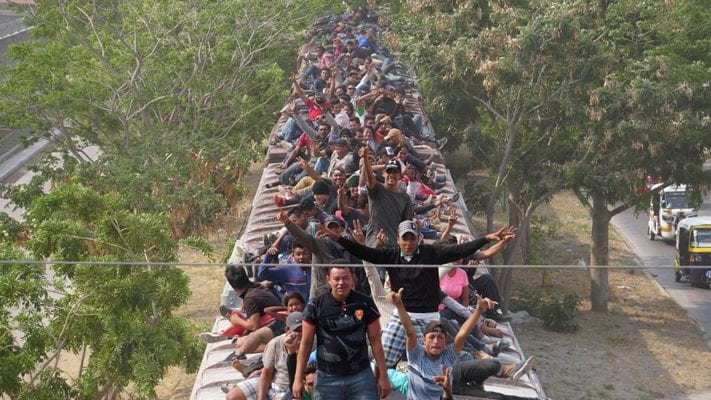 Hundreds of migrants board 'the Beast' train in Mexico in risky move to get closer to US border